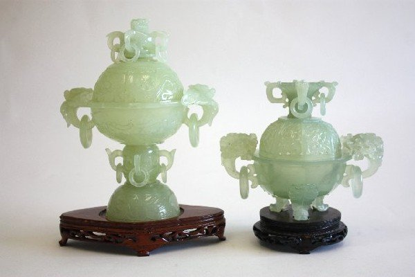 73: Two carved Jade covered pieces on stands
