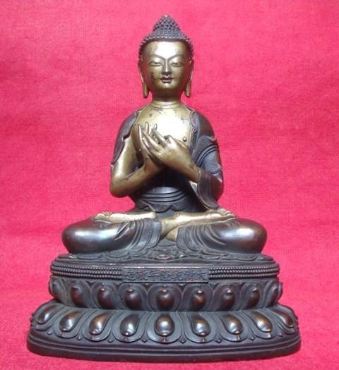 303A: Sino-Tibetan bronze figure of Buddha Seated
