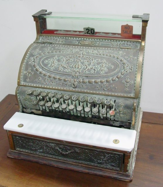 5: Antique brass cash register