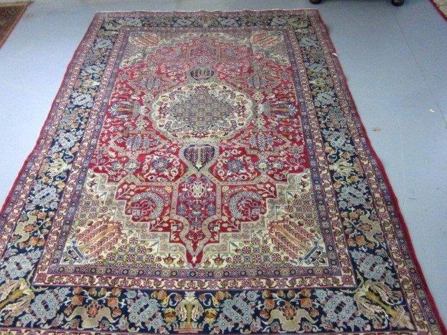 1006: Persian red field center medallion rug