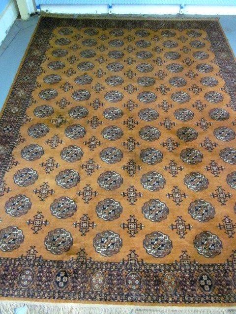 1007: Bukara gold field & black rug