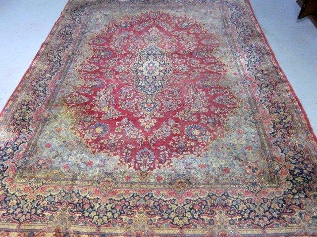 1008: Sarouk red field center medallion rug