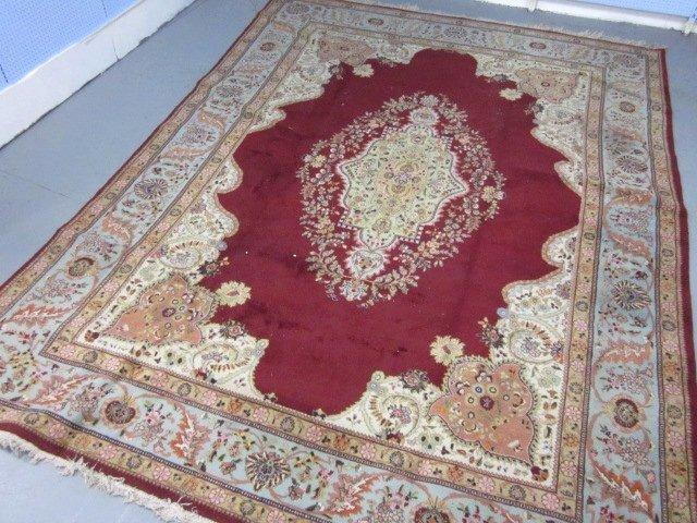 1009: Kermin red field center medallion rug