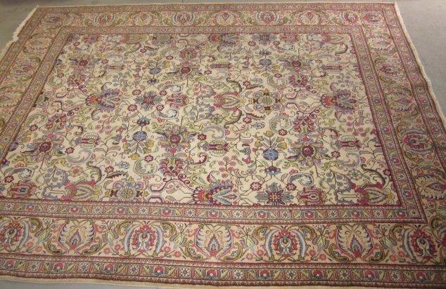 11: Ivory Oriental machine made rug