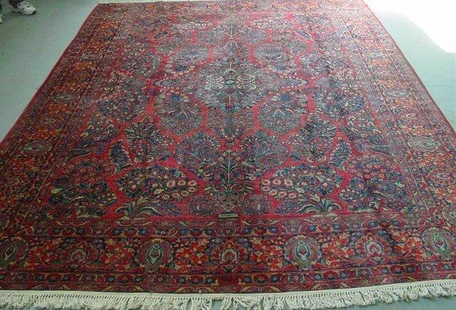 12: Handmade red Sarouk Persian rug