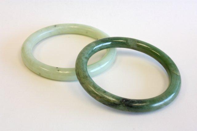 504A: Two green jade bracelets
