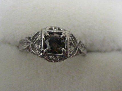506: 14kt gold & brown diamond ring