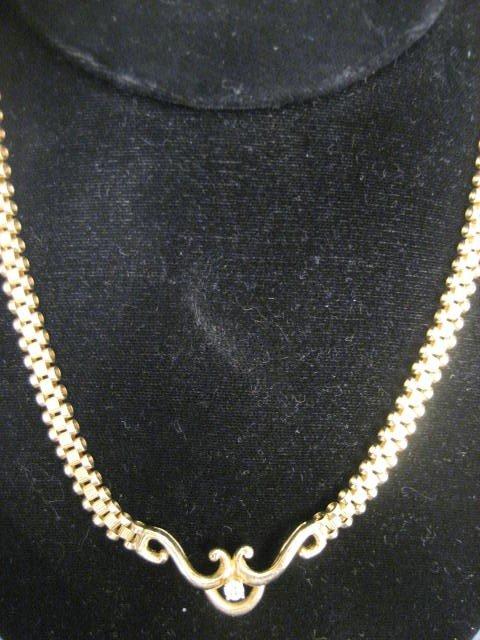 509: 14kt gold & diamond necklace