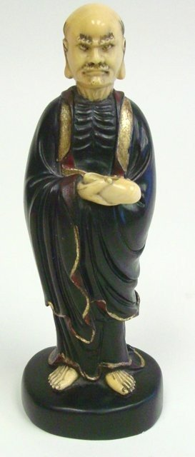 "1127: Jitan wood & ivory ""Chinese Man Holding Shoe"""