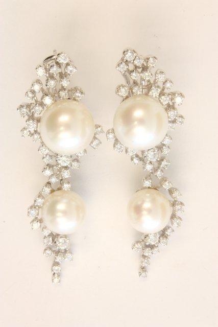 506: Pair pearl & diamond encrusted earrings