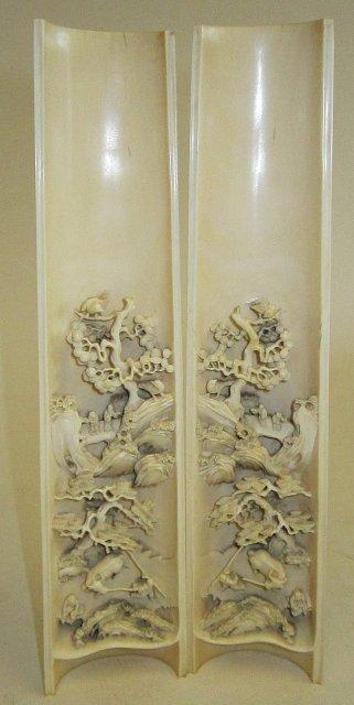 "509: Pair carved relief ivories of ""Village Life"""