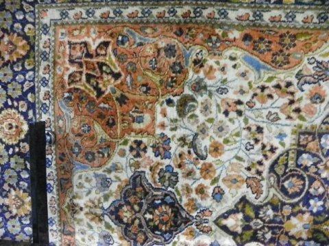 13: Ivory & blue center medallion rug