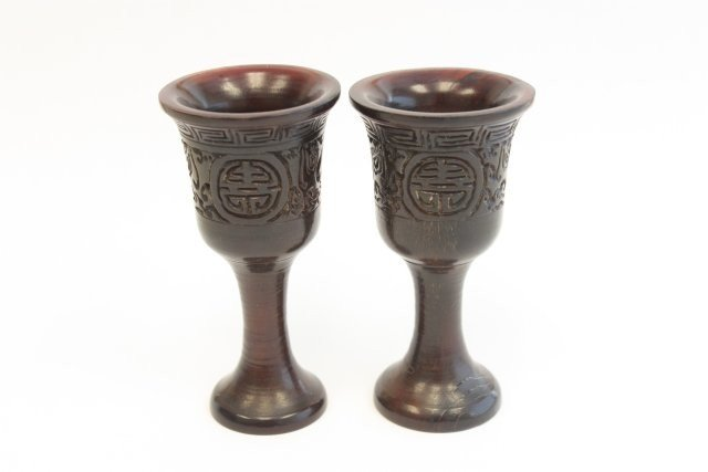 19: Finely carved pair of rhinocerous horn cups