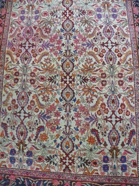 2B: Semi-antique evenly low ivory Tabriz rug