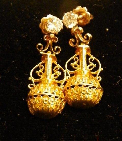 601: Pair 14kt gold & diamond earrings