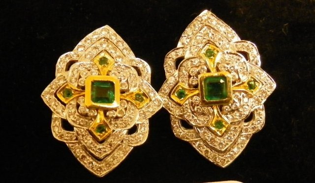 602A: 18kt 2 tone gold,diamond earrings with omega chip
