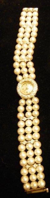 603: Pearl, diamond & white gold ladies watch