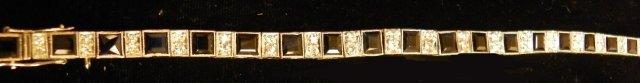 604: Platinum, diamond & sapphire tennis bracelet