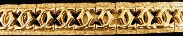 611: Cartier 18kt gold & diamond bracelet