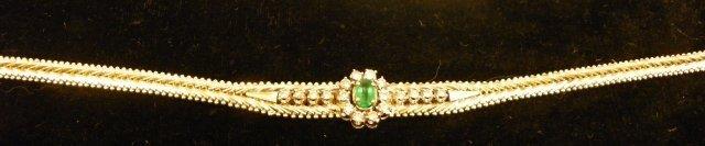 613: 14kt gold, diamond & emerald bracelet