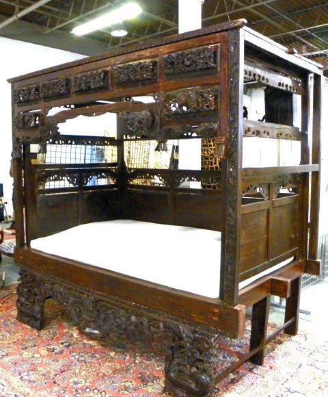 1000: 19th c. hand carved teakwood opium bed