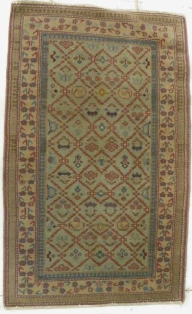13: Antique ivory Tabriz rug