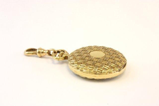 1012: 14kt gold Swiss made ladies pocket watch