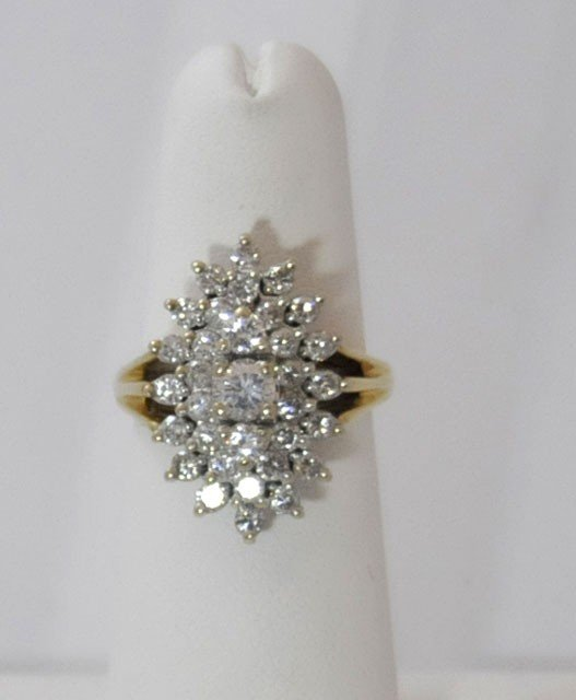 1017: Marquis shaped diamond ring with yellow gold