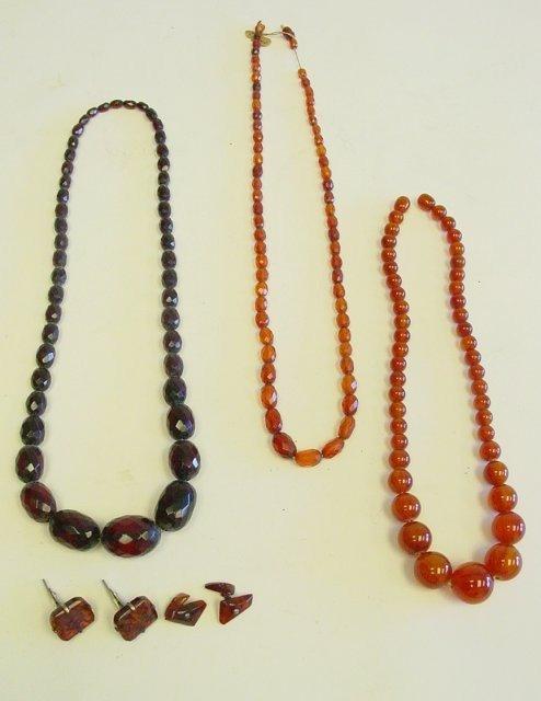 1021: 3 necklaces & 2 pair cufflinks - amber