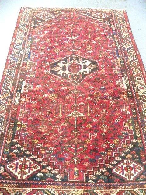 24: Center medallion Tabriz rug