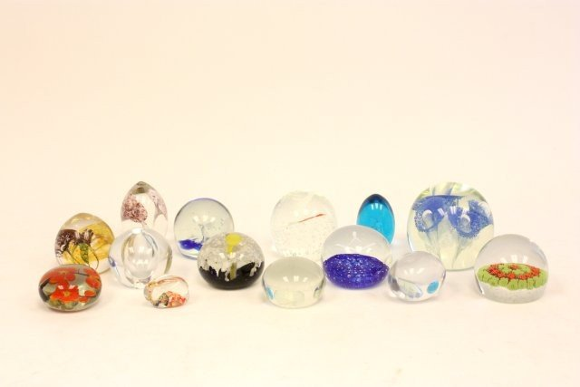 61: 14 glass paperweights