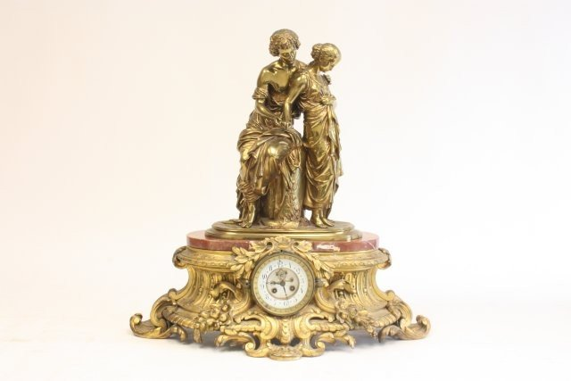 218: 19th c. bronze and marble figural clock