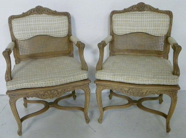 320: Pair cane back walnut arm chairs