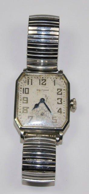 1002: Men's Waltham 14kt gold wrist watch