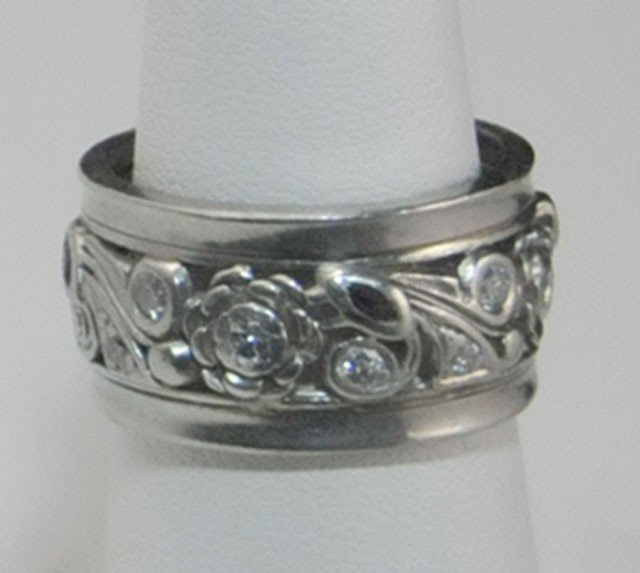 1005A: Platinum diamond and ruby ring