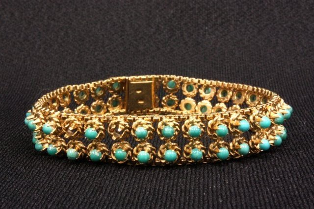 1006: 14kt gold channel bracelet with turquoise stones