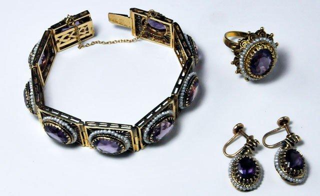 1009A: 14kt gold bracelet, earrings & ring set