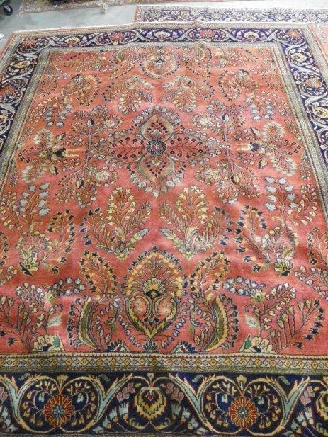 12: Red Sarouk rug