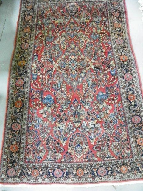 18: Semi antique red Sarouk Persian rug