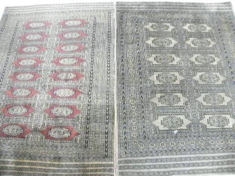 21: 2 handmade Pakistani rugs