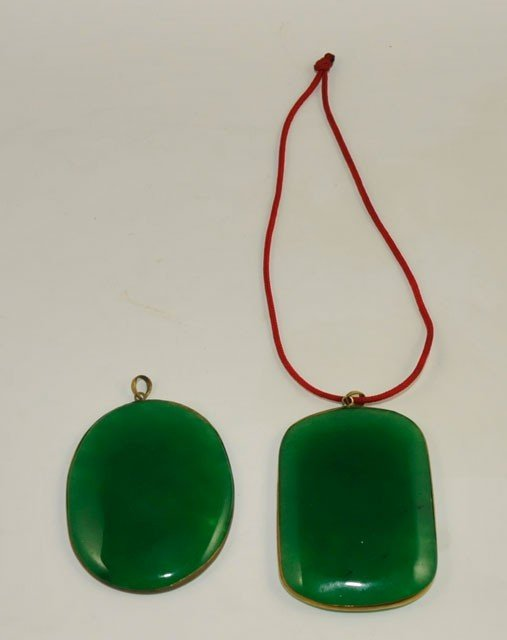 1006: 2 jade pendants with plated brass frame