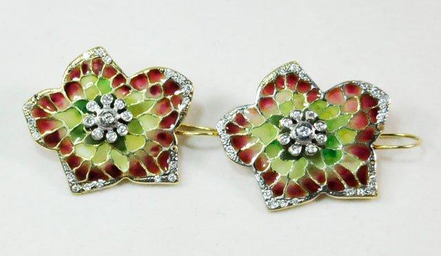1010: Pair of unusual 14kt gold & diamond earrings