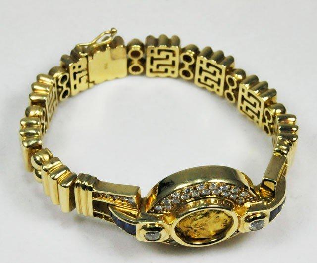 1012: 18kt gold, diamond & sapphire coin bracelet