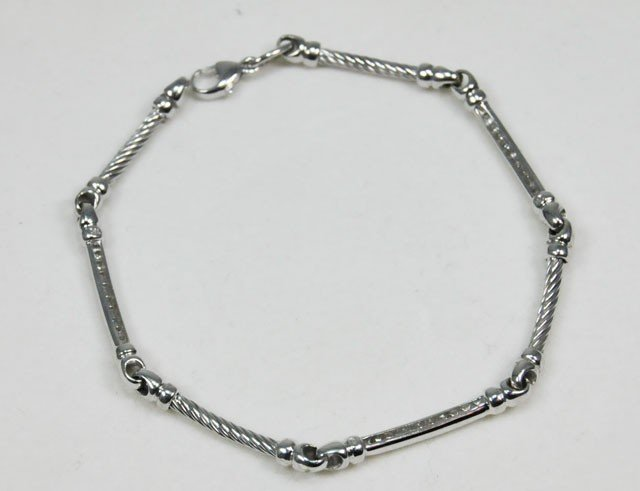 1017: 18kt white gold & diamond bracelet by Charriol