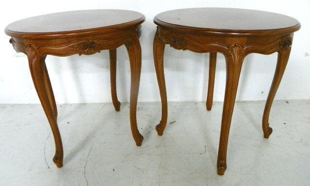 1131: Pair French style round mahogany tables