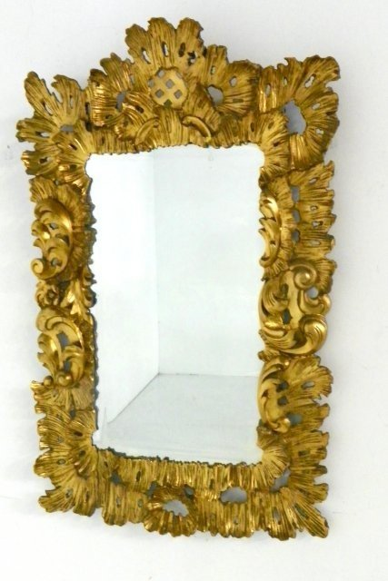 1297: Antique carved gilded mirror