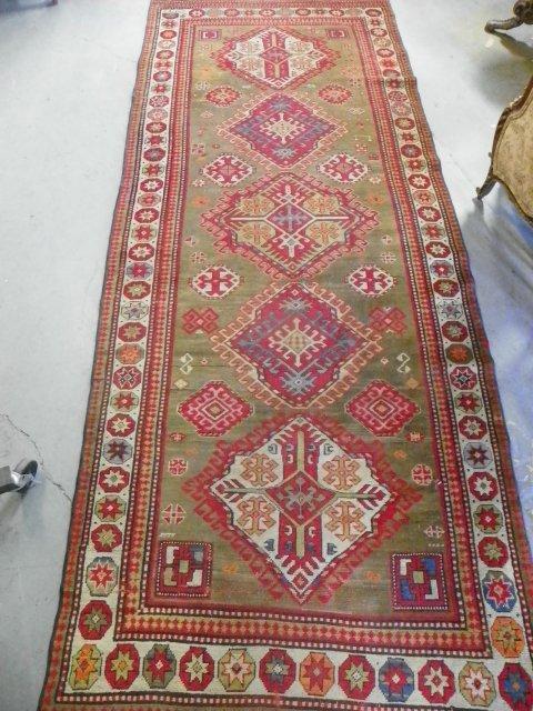 5: Antique Caucasian rug