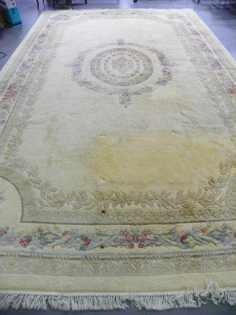11: Center medallion ivory Karastan rug