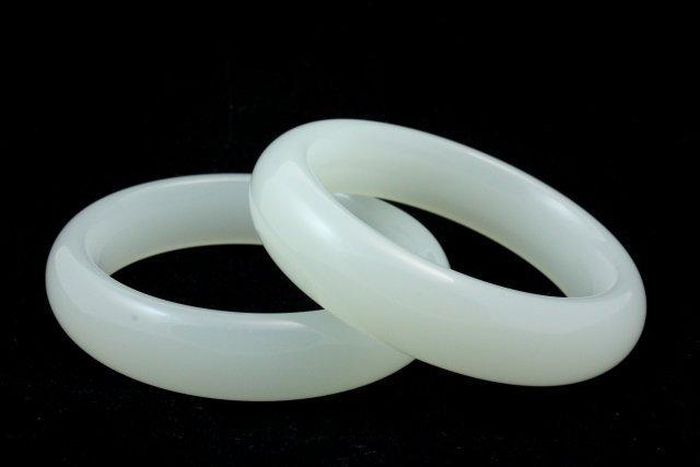 25: 2 white jade style bracelets