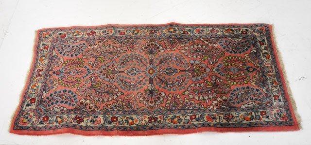 13: Red Sarouk rug